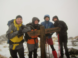 Wet and cold but still smiling on the tops