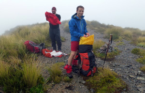 Snack break in the clag on the way up Mitre Peak