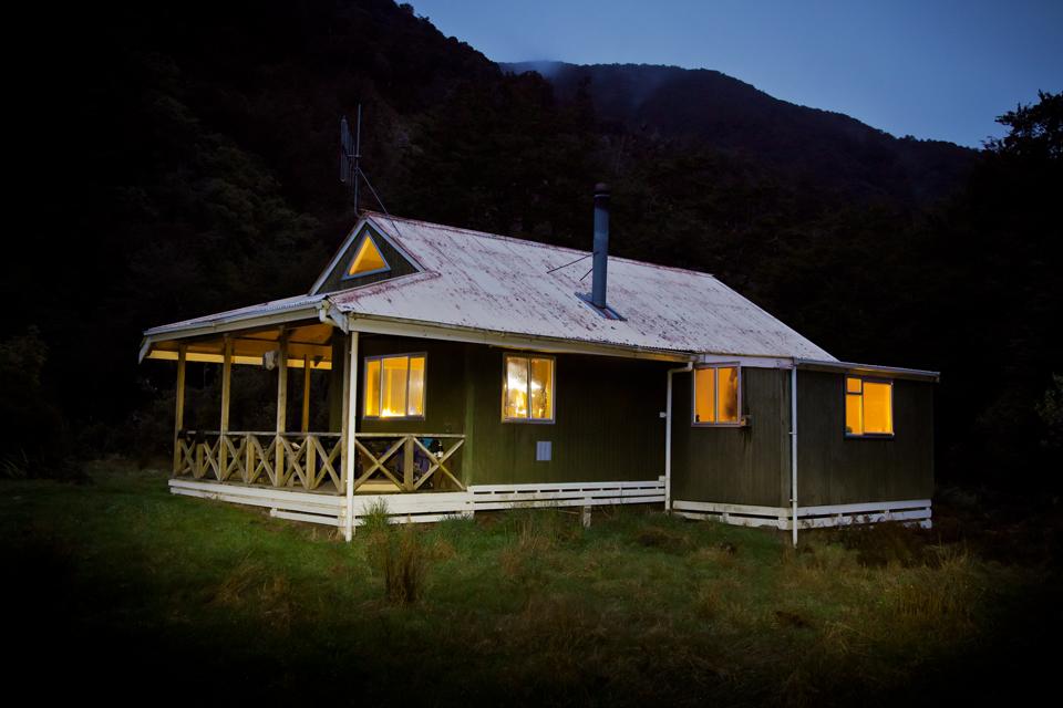 Mitre Flats Hut at dusk