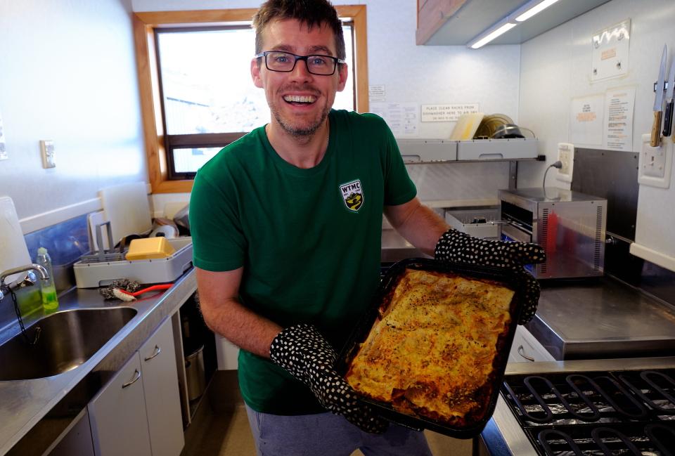 Nick holding a dish of lasagne at WTMC Ski Lodge