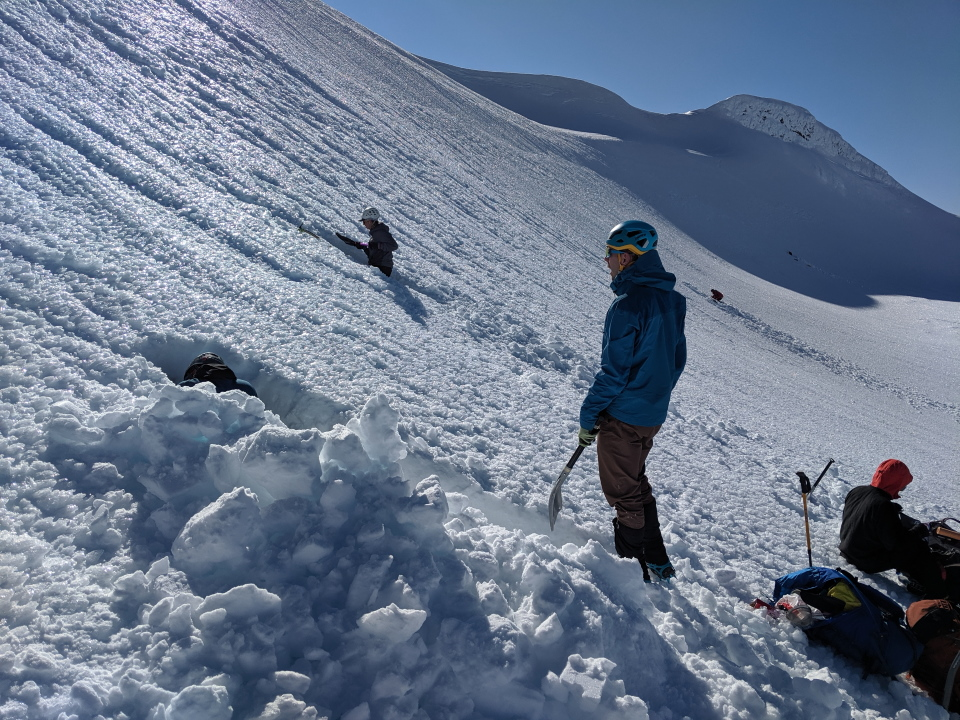 People digging tunnels in the snow at Mt Ruapehu