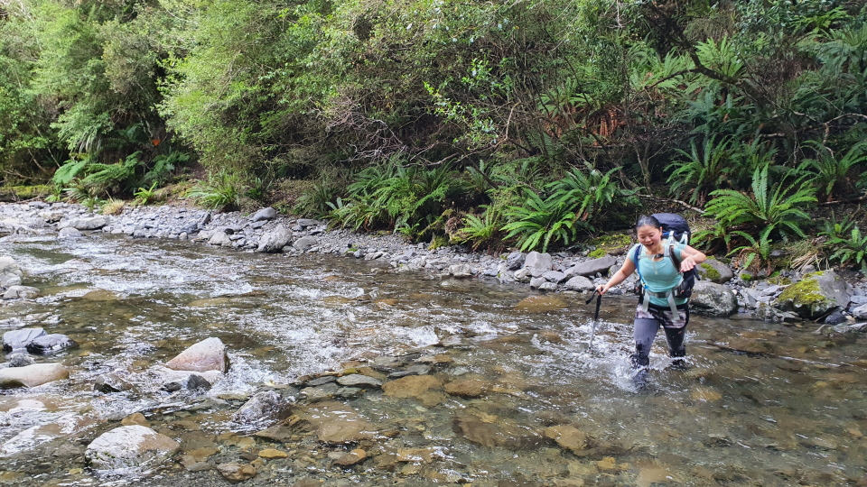 Tramper crossing a creek