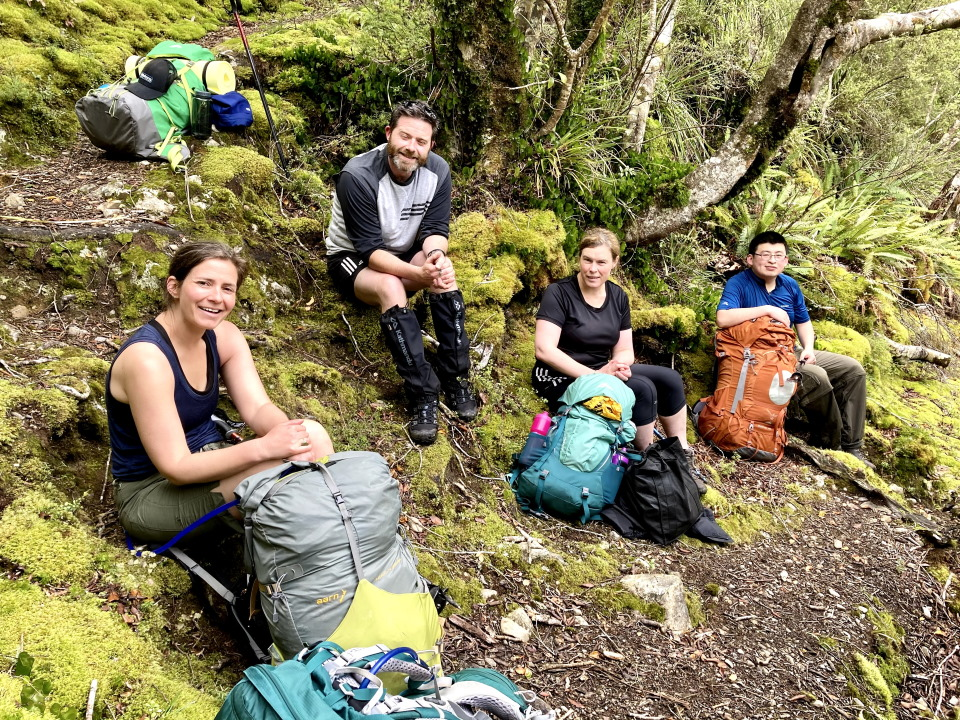 Trampers resting on the Iron Gate Hut Track