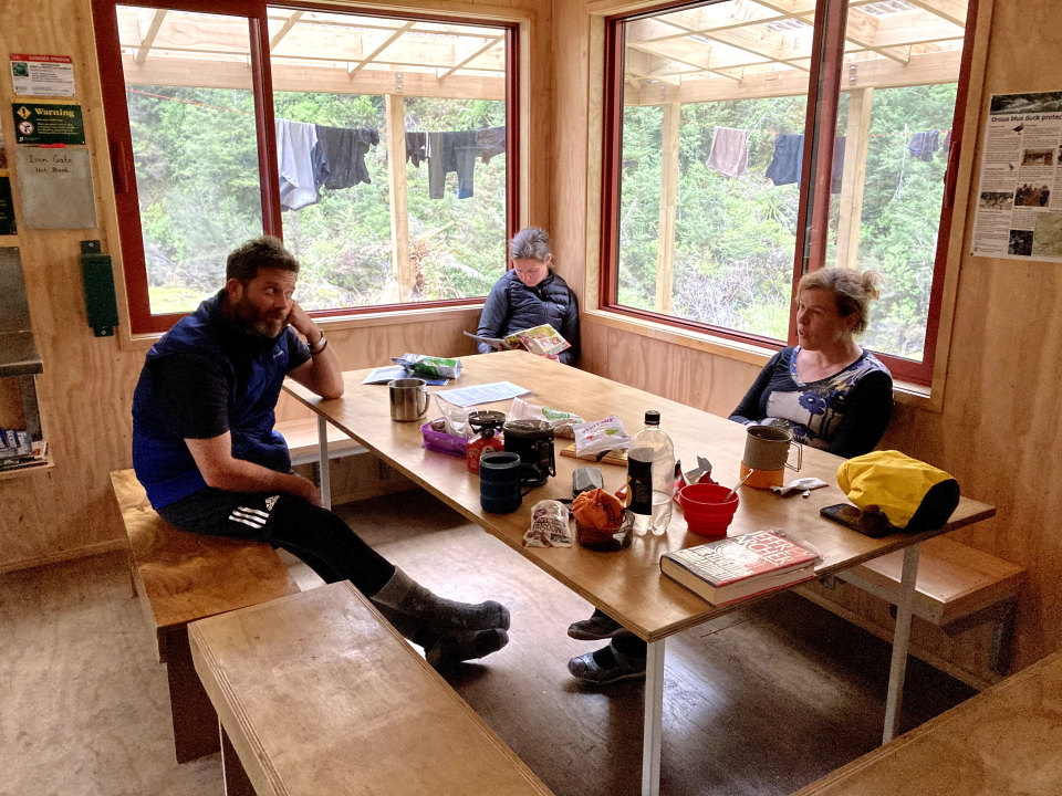 Trampers relaxing in Iron Gate Hut