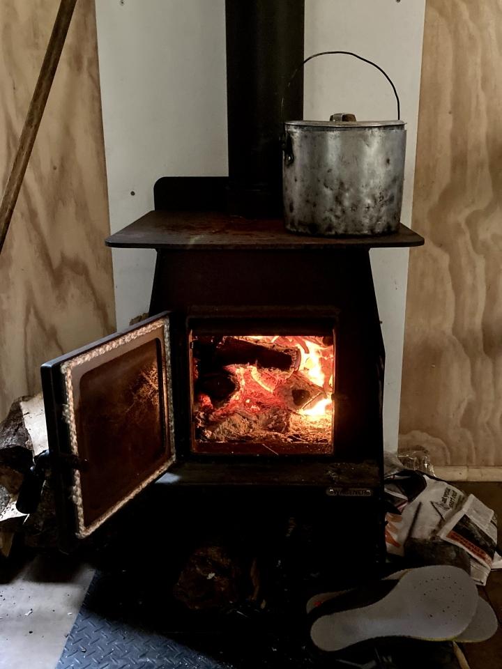 Fire burning in Iron Gate Hut