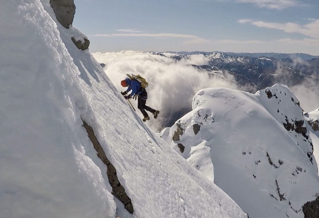 Elisabet navigates the exposed horizontal traverse just before the final climb to the High Peak of Mt Rolleston