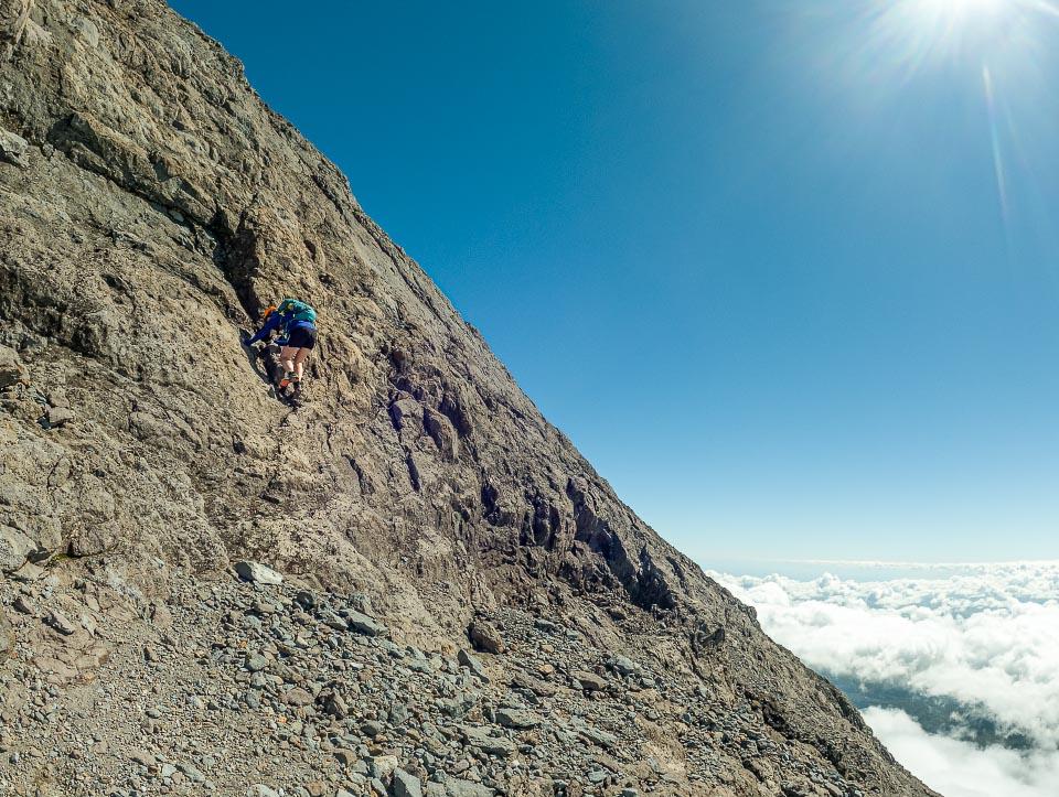 Aimee climbing a step in the ridge