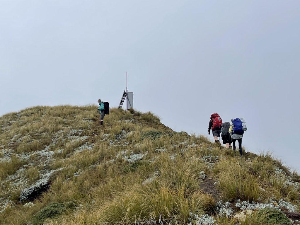 Loretha, Jane, Jamie, and Anna reach the Tunupō trig