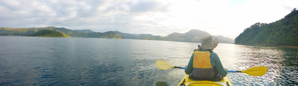 View of a kayaker on open water