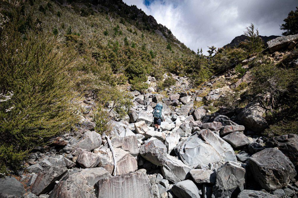 A dry, boulder-filled creek bed