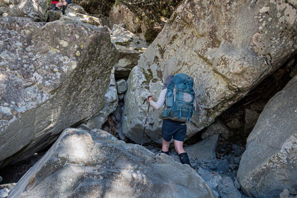 Tramper negotiating large boulders