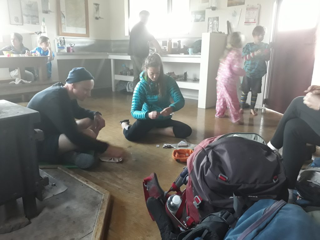 Trampers playing games in a hut