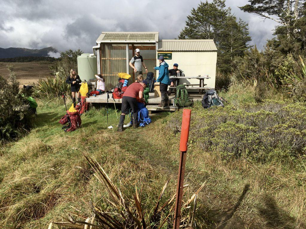 Six trampers at a hut
