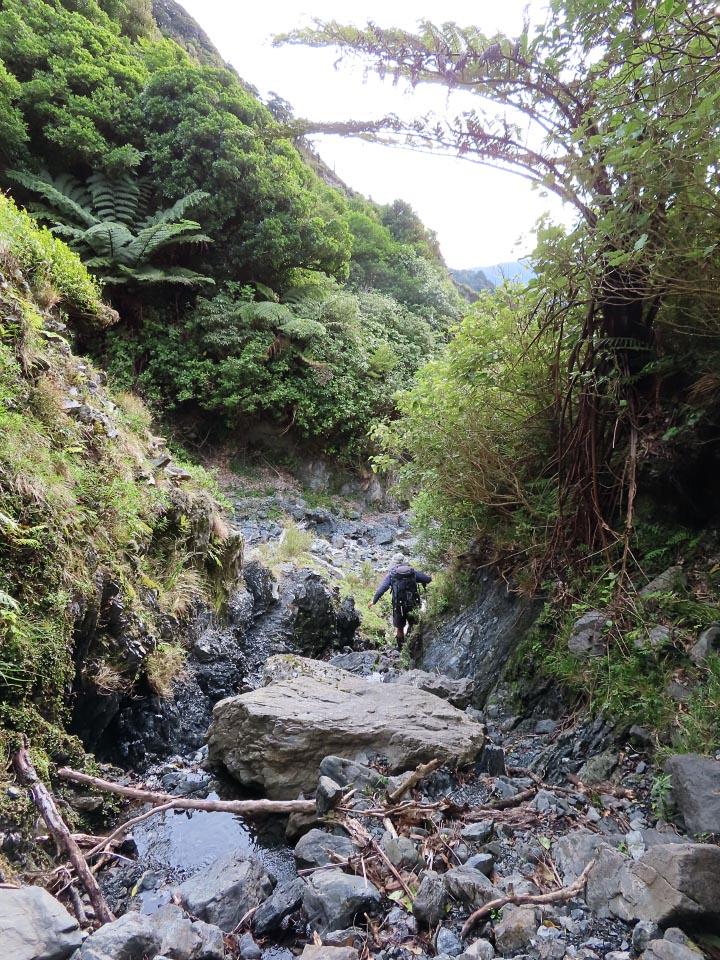 Tramper in a boulder-filled stream bed
