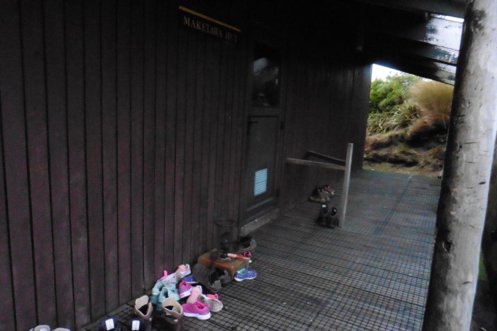 Shoes outside a hut