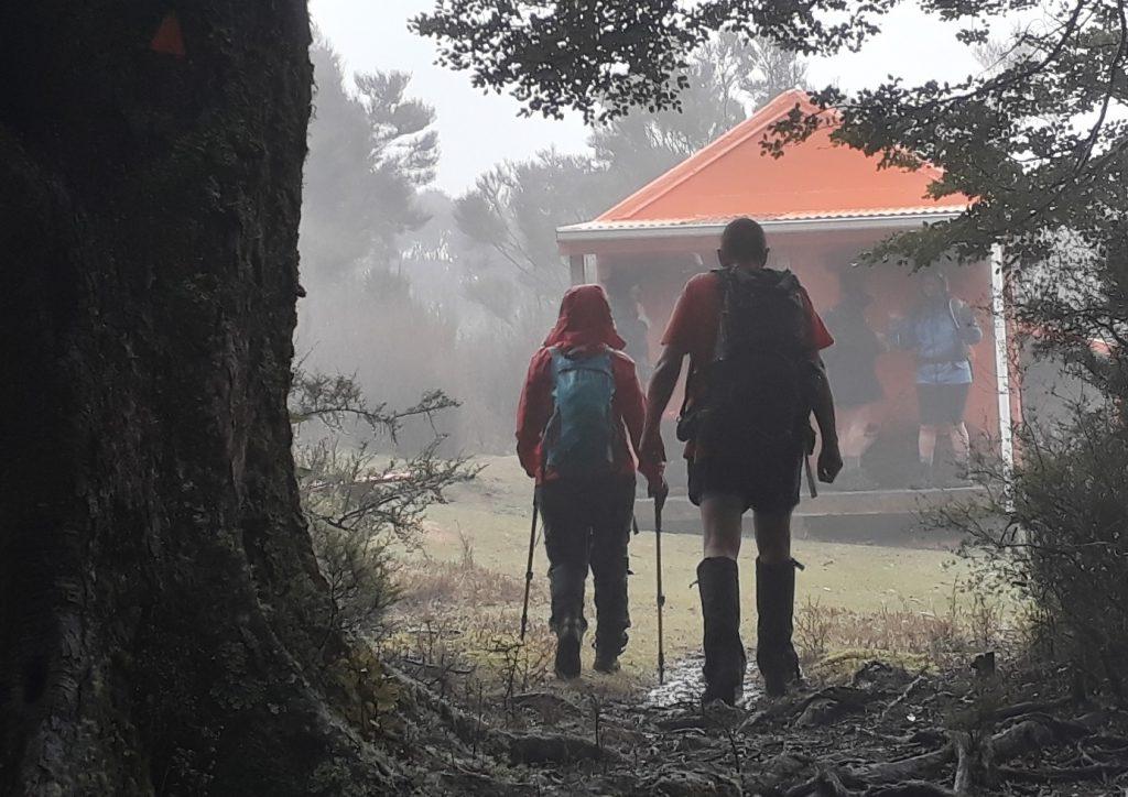 Tramping through mist to hut