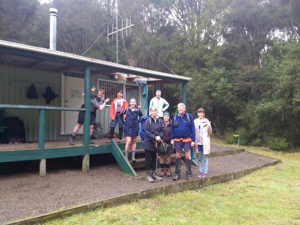 Trampers outside a hut