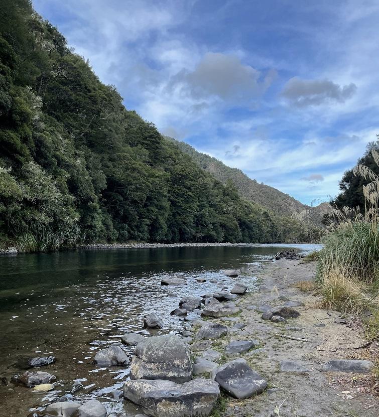River valley below hills