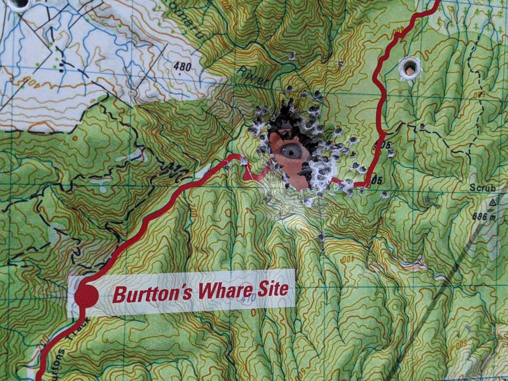 Map board with shotgun holes