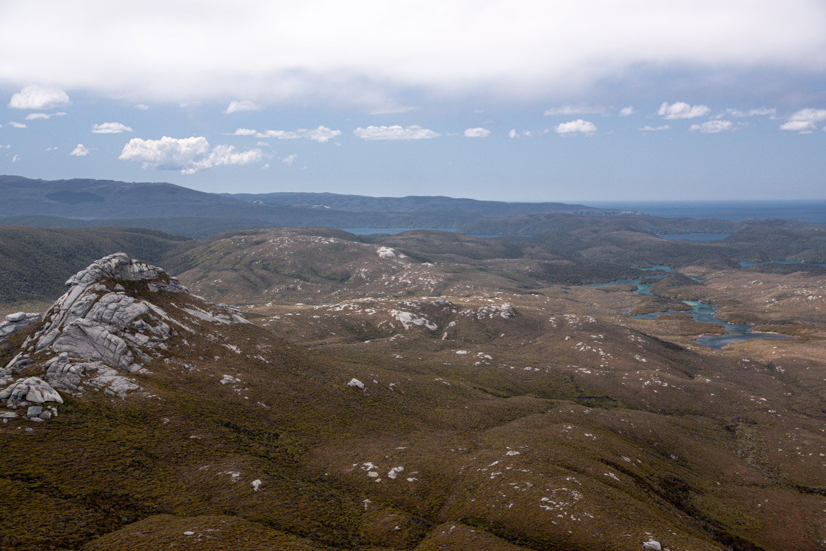 On the summit of Gog. Magog left, Cook Arm right, the Tin Range distant left skyline